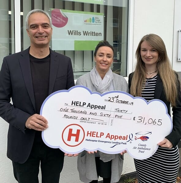 Jason Dennis, from the County Air Ambulance Trust's fundraising executive team, with Sue Spilsbury, centre, and Kaylee Cubberley, of Wills & Legal Services, with the latest cheque donation.