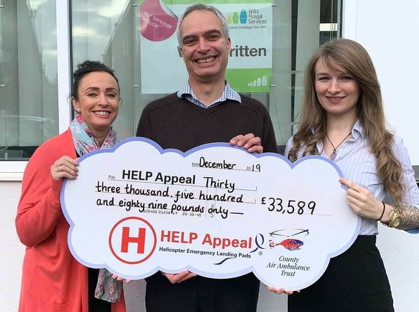 Sue Spilsbury, of Wills & Legal Services, Jason Dennis, from the HELP Appeal's fundraising executive team, and Kaylee Cubberley, of Wills & Legal Services